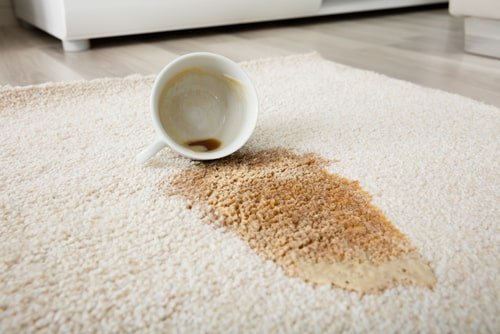 Drink stain on white carpet